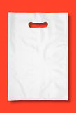 Plastic bag on red Royalty Free Stock Photos