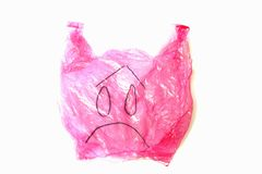 Plastic bag with sad emotion on face isolated against white background royalty free stock photos