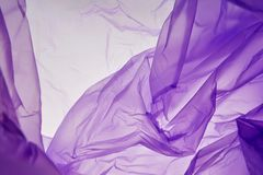 Plastic bag. Splash texture background isolated. Purple seasonal colors abstract background royalty free stock photography