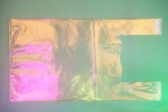 Plastic bag on trendy pink and green background. royalty free stock photography