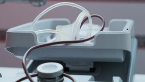 Plastic bag with tubes filled with blood. Blood transfusion station. Blood donation equipment in hospital