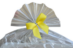 Plastic bag with yellow ribbon bow Royalty Free Stock Image