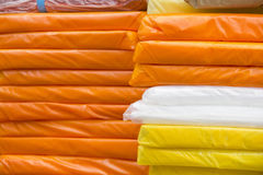 Plastic bags. Stacks of colorful plastic bags at a shop Stock Images