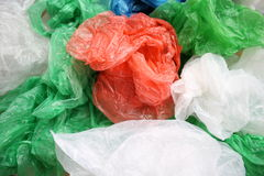 Plastic bags. Many Garbage Plastic Bags With Different Colours Piled Up Stock Photos