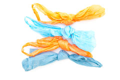 Plastic bags. Used plastic bags tied up on a white background stock image