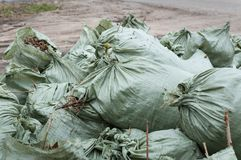 Plastic bags filled with rubbish. Many plastic bags filled with rubbish. Close-up Stock Image