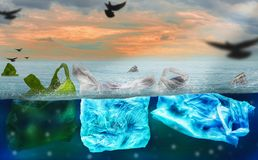 Plastic bags floating on surface of ocean, polluting environment of world and marine animals,concept of reducing plastic waste and. Conserving earth and waste royalty free stock photos