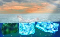 Plastic bags floating on surface of ocean, polluting environment of world and marine animals,concept of reducing plastic waste and. Conserving earth and waste royalty free stock image