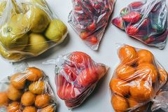 Plastic bags full of fruits and vegetables. Climate change concept. Closeup of plastic bags full of fruits and vegetables. Climate change and less plastic royalty free stock image