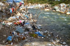 Plastic Garbage Polution in mountain stream Stock Photography