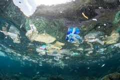 Plastic Bags and Garbage in Tropical Pacific Ocean royalty free stock image