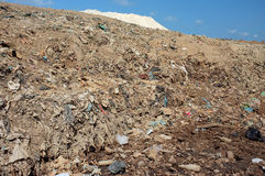 Plastic bags, trash, household garbage and toxic industrial waste contaminates soil, land and water at a polluted landfill site. BALI, INDONESIA - APRIL 30 Royalty Free Stock Photo