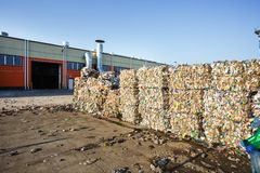 Plastic bales at the waste processing plant. Separate garbage collection. Recycling and storage of waste for further disposal. Business for sorting and stock photo