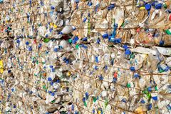 Plastic bales at the waste processing plant. Separate garbage collection. Recycling and storage of waste for further disposal. stock image