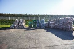 Plastic bales at the waste processing plant. Separate garbage collection. Recycling and storage of waste for further disposal. Business for sorting and royalty free stock photo