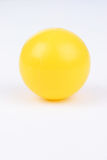 Plastic ball. Yellow plastic ball on white background Royalty Free Stock Image