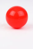 Plastic ball. Red plastic ball on white background Stock Image