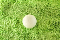 Plastic ball. On green fabric Royalty Free Stock Photos