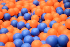 Plastic balls on kids playground. Huge amount of orange and blue kids plastic balls used in kids fun corners Stock Images