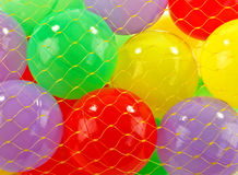 Plastic balls. Little red,yellow, green and mauve plastic balls royalty free stock photography
