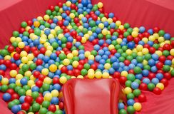 Plastic balls in red pool Royalty Free Stock Image