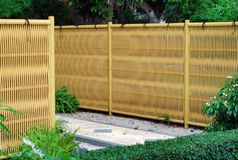 Plastic bamboo fence. Japanese style plastic bamboo fence in japanese garden Royalty Free Stock Photo