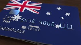 Plastic bank card featuring flag of Australia. National banking system related 3D rendering. Plastic bank card featuring state flag Royalty Free Stock Photography