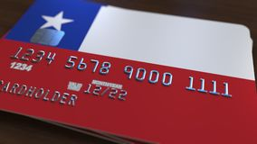 Plastic bank card featuring flag of Chile. Chilean banking system conceptual 3D rendering. Plastic bank card featuring flag. National banking system conceptual Royalty Free Stock Photography