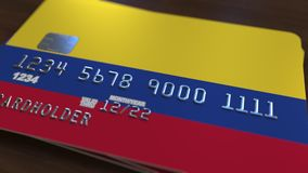 Plastic bank card featuring flag of Colombia. National banking system related 3D rendering. Plastic bank card featuring state flag Royalty Free Stock Image