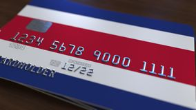 Plastic bank card featuring flag of Costa Rica. National banking system related 3D rendering. Plastic bank card featuring state flag Stock Photography