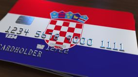 Plastic bank card featuring flag of Croatia. National banking system related 3D rendering. Plastic bank card featuring state flag Royalty Free Stock Photos