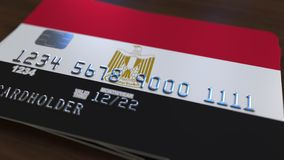Plastic bank card featuring flag of Egypt. National banking system related 3D rendering. Plastic bank card featuring state flag Royalty Free Stock Images