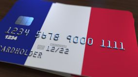 Plastic bank card featuring flag of France. National banking system related 3D rendering. Plastic bank card featuring state flag Stock Photo