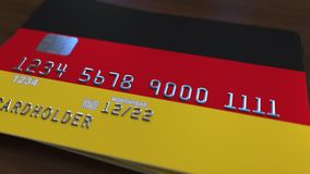 Plastic bank card featuring flag of Germany. National banking system related 3D rendering. Plastic bank card featuring state flag Royalty Free Stock Photography