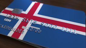 Plastic bank card featuring flag of Iceland. National banking system related 3D rendering. Plastic bank card featuring state flag Royalty Free Stock Photos