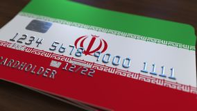 Plastic bank card featuring flag of Iran. National banking system related 3D rendering. Plastic bank card featuring state flag Stock Photography