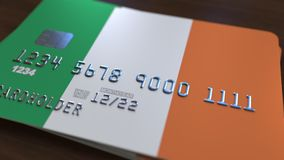 Plastic bank card featuring flag of Ireland. Irish national banking system related animation. Plastic bank card featuring state flag stock video