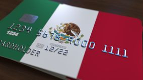 Plastic bank card featuring flag of Mexico. National banking system related 3D rendering. Plastic bank card featuring state flag Royalty Free Stock Image