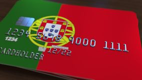 Plastic bank card featuring flag of Portugal. National banking system related 3D rendering. Plastic bank card featuring state flag Royalty Free Stock Photography