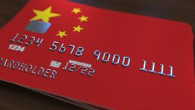 Plastic bank card featuring flag of China. National banking system related 3D rendering. Plastic bank card featuring state flag Royalty Free Stock Photography