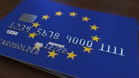 Plastic bank card featuring flag of the European Union. National banking system related 3D rendering. Plastic bank card featuring state flag Stock Photography