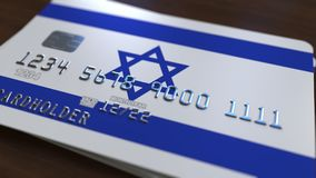 Plastic bank card featuring flag of Israel. National banking system related 3D rendering. Plastic bank card featuring state flag Stock Images