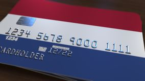 Plastic bank card featuring flag of the Netherlands. National banking system related 3D rendering. Plastic bank card featuring state flag Stock Photography