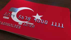 Plastic bank card featuring flag of Turkey. National banking system related animation. Plastic bank card featuring state flag stock footage