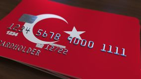 Plastic bank card featuring flag of Turkey. National banking system related 3D rendering. Plastic bank card featuring state flag stock image