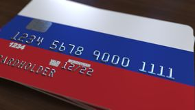 Plastic bank card featuring flag of Russia. National banking system related 3D rendering. Plastic bank card featuring state flag Royalty Free Stock Photos