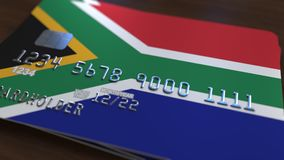 Plastic bank card featuring flag of South Africa. National banking system related 3D rendering. Plastic bank card featuring state flag Stock Photo
