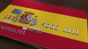 Plastic bank card featuring flag of Spain. National banking system related 3D rendering. Plastic bank card featuring state flag Royalty Free Stock Image