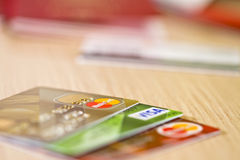 Plastic Bank cards Visa and mastercard are on the table. VOLGOGRAD - APRIL 22: plastic Bank cards Visa and mastercard are on the table .April 22, 2015 in Royalty Free Stock Photos