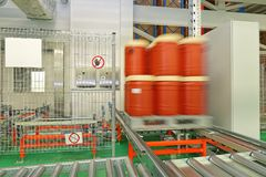 Plastic Barrels Conveyor Moving royalty free stock image